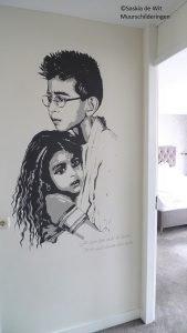 portret op de muur laten schilderen